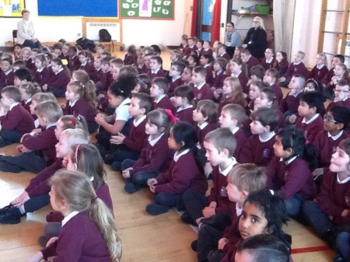 Foundation and Key stage 1 pupils eagerly awaiting the results of the raffle announcement